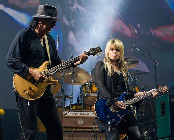 Orianthi performs with Carlos Santana