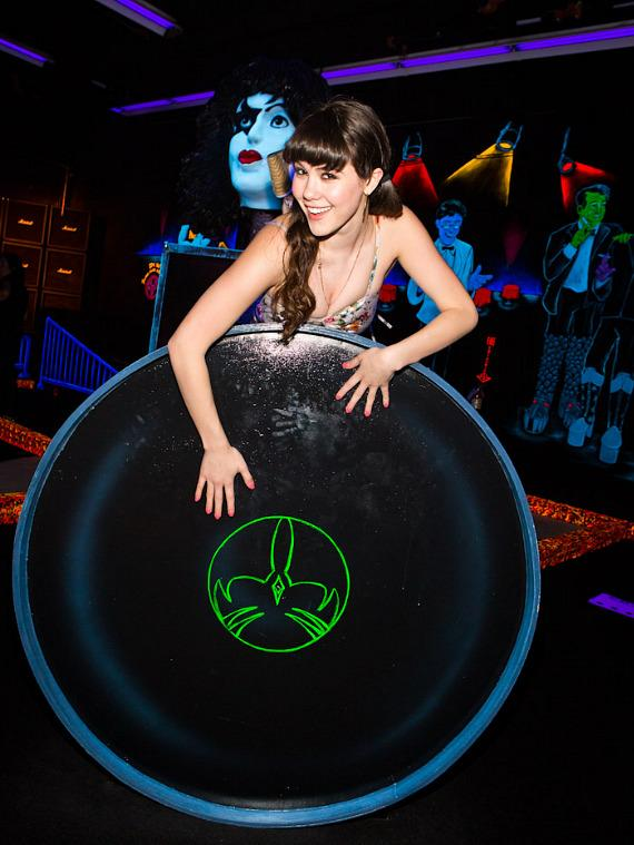 Claire Sinclair poses with KISS drum at KISS Monster Mini Golf in Las Vegas