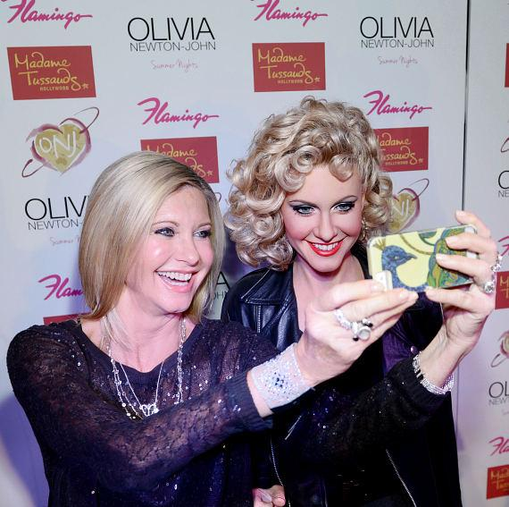 Olivia Newton-John takes selfie with new Madame Tussauds Hollywood Wax Figure at The Flamingo Las Vegas