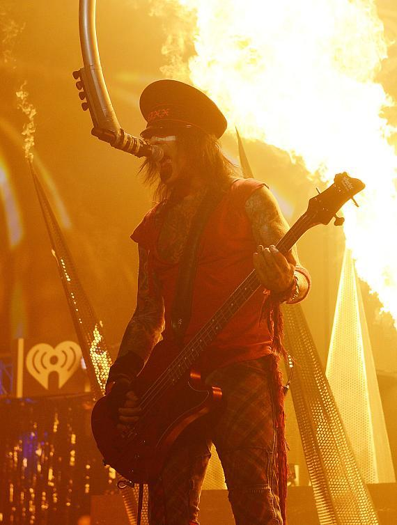 Musician Nikki Sixx of Motley Crue performs onstage during the 2014 iHeartRadio Music Festival at the MGM Grand Garden Arena