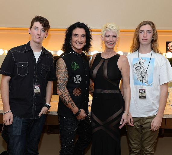 Robin McAuley (2nd from L) and Gina McAuley (2nd from R) backstage at 'Raiding The Rock Vault'