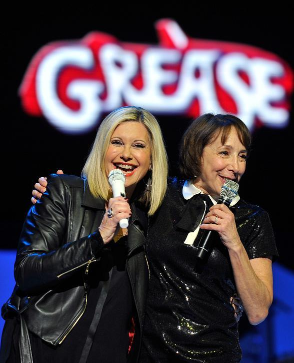 Actress Didi Conn and Olivia Newton-John sing