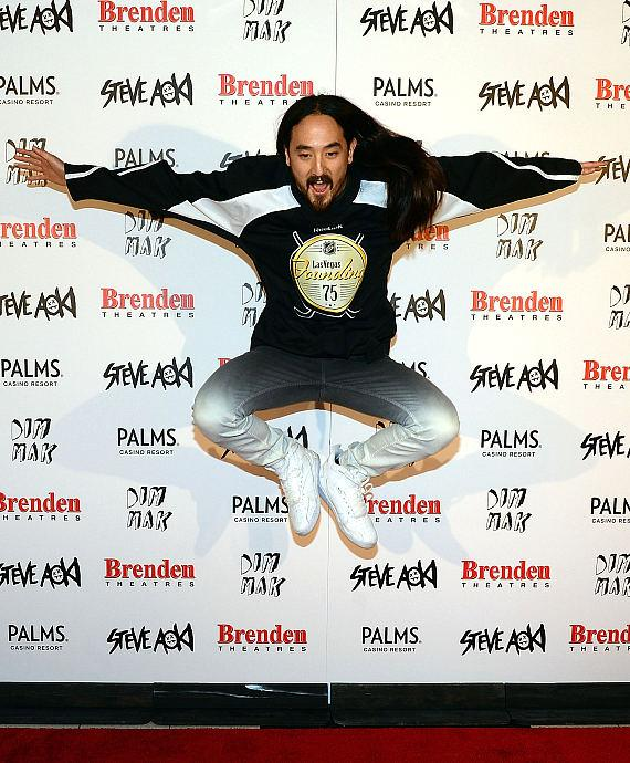 Steve Aoki jumps up in the air with excitement while being presented with Brenden 'celebrity star' at Palms Casino Resort