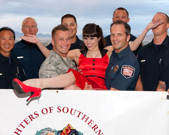 Claire Sinclair with firefighters at the House of Blues Foundation Room at Mandalay Bay