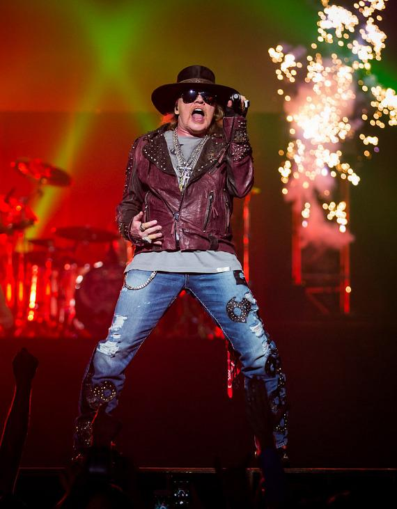 Axl Rose performs with fireworks in background