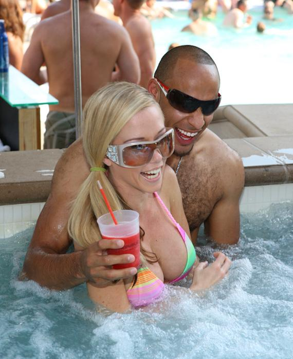 Kendra Wilkinson and fiance Hank Baskett in the pool at WET REPUBLIC