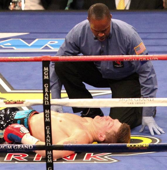 The referee checks Hatton who is out cold