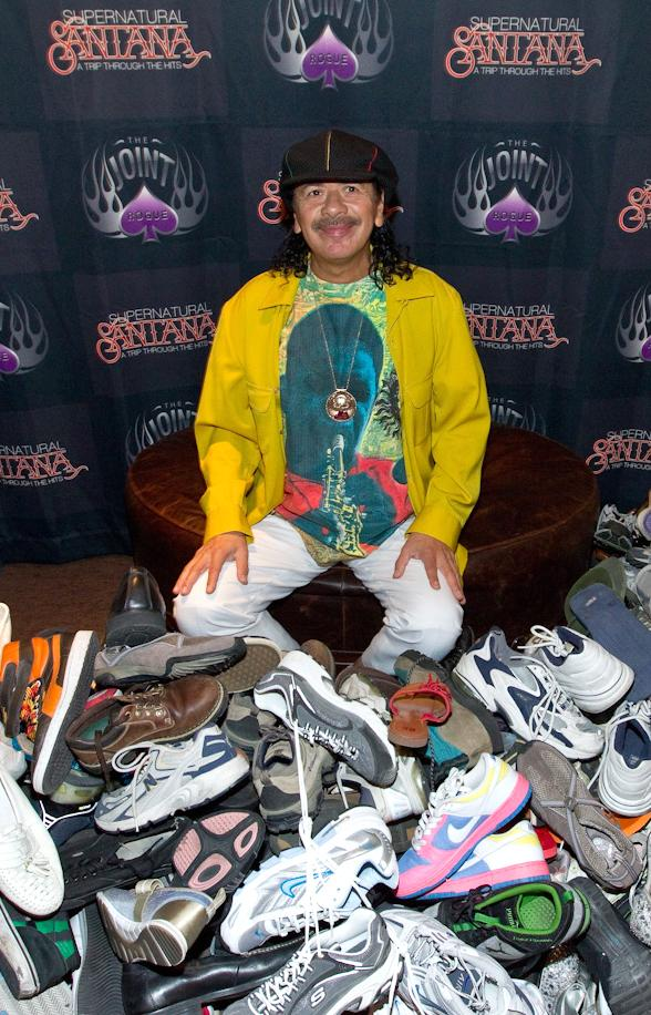 Carlos Santana at The Joint inside Hard Rock Hotel & Casino with the shoe donations