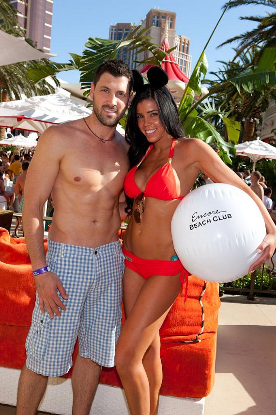"Maksim Chmerkovskiy of ""Dancing with the Stars"" poses with a server at Encore Beach Club's one year anniversary celebration"