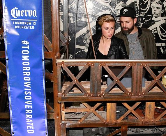 Sarah Barthel and Josh Carter of Phantogram in the DJ booth enjoying the moment at Cuervo Nights, Commonwealth in Las Vegas