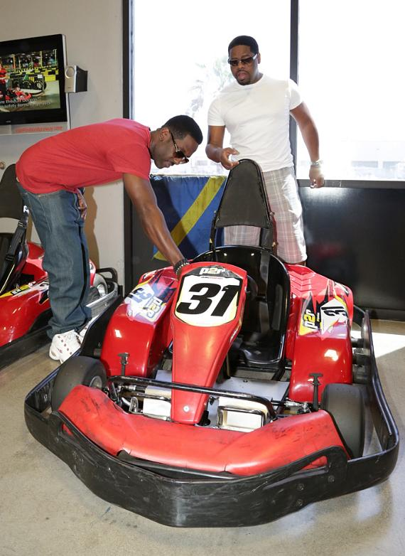 Nathan Morris (white T) and Shawn Stockman (red T)  check out a race car at Pole Position in Las Vegas