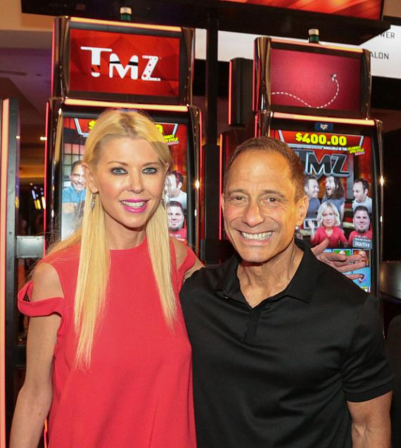 Tara Reid and Harvey Levin with TMZ slot machine