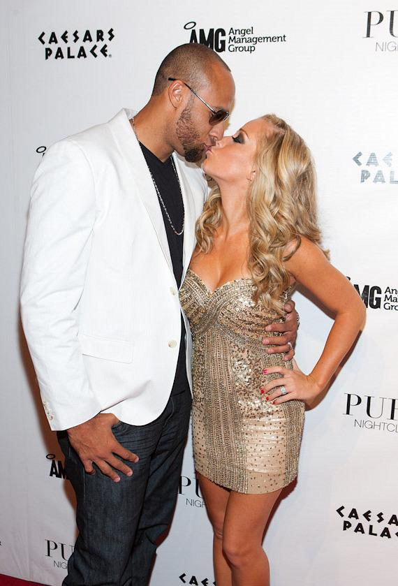 Kendra Wilkinson-Baskett and Hank Baskett on red carpet at PURE Nightclub