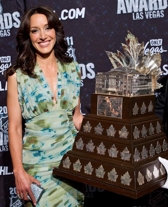 Jennifer Beals poses with the Conn Smythe Trophy