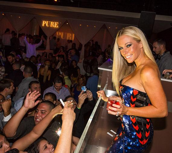 Kendra Wilkinson-Baskett with crowd at PURE Nightclub