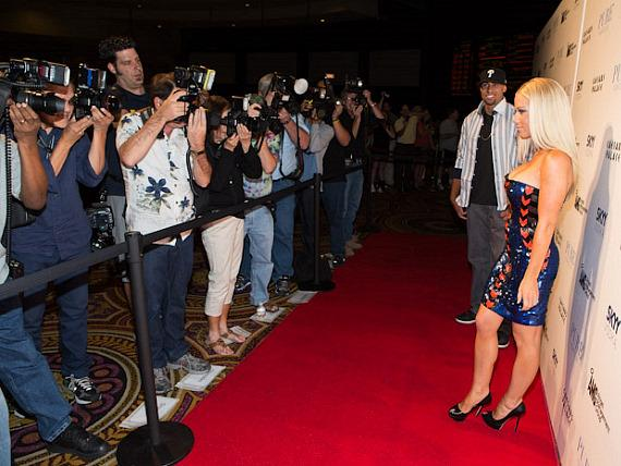 Kendra Wilkinson-Baskett with photographers on red carpet at PURE Nightclub