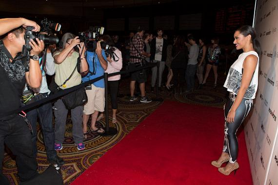 Kat Graham with photographers on red carpet inside PURE Nightclub