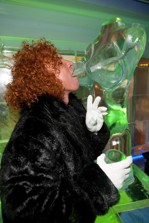 Carrot Top drinks through an ice sculpture bust