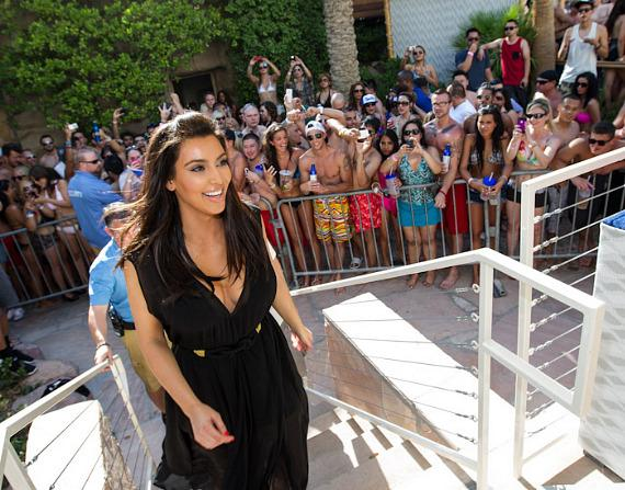 Kim Kardashian arrives with a smile at REHAB at Hard Rock Hotel