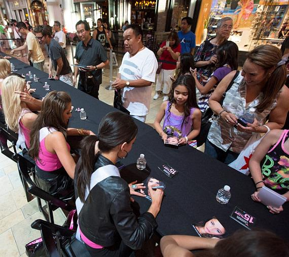 Miss USA Nana Meriwhether and 51 Miss USA contestants sign autographs at Chinese Laundry in Fashion Show Mall