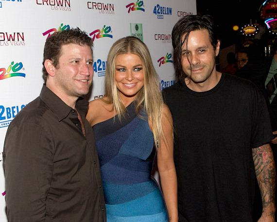 Crown owner Darin Feinstein, Carmen Electra and Rob Patterson of KORN