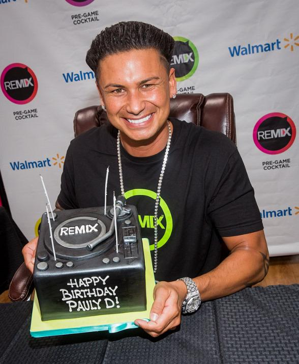 DJ Pauly with birthday cake at Walmart