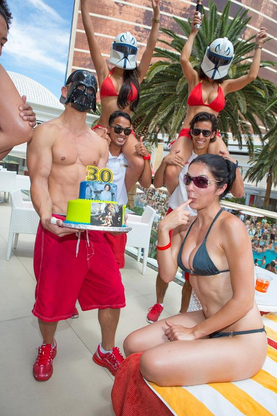 Encore Beach Club staff presents Adrianne Curry with Star Wars birthday cake