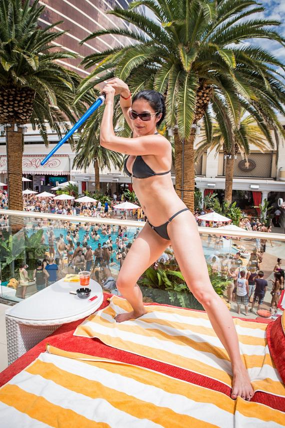 Adrianne Curry plays with light saber at Encore Beach Club