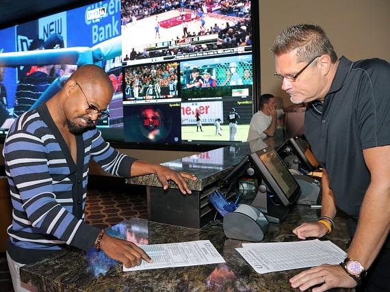 """Sugar"" Shane Mosley places commemorative bet at The Cromwell's all-new sportsbook on Wednesday, Aug. 22 in Las Vegas"