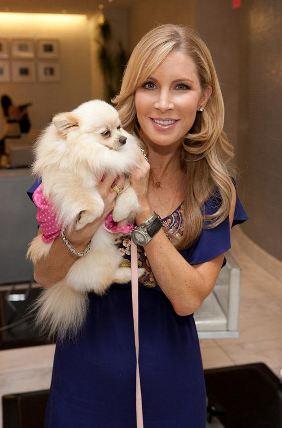 "Alicia Jabos with Paris Hilton's dog ""Marilyn Monroe"""