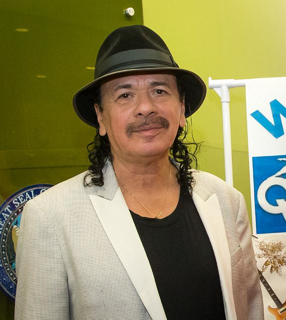Carlos Santana tours Opportunity Village's Ralph and Betty Engelstad Campus