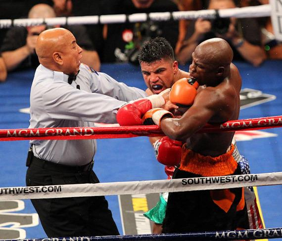 Referee Joe Cortez steps in to stop the fight