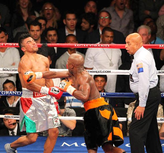 In a controversial surprise finish Floyd Mayweather Jr. Knocks Out Victor Ortiz in what appeared to stun ring referee Joe Cortez