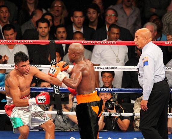 Ortiz goes down after two punches by Mayweather