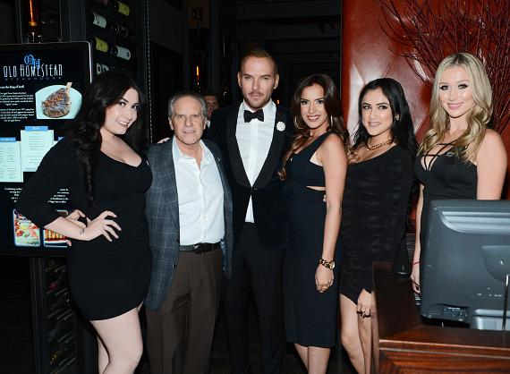 Old Homestead co-owner Greg Sherry and Caesars Palace headliner Matt Goss with Old Homestead team members