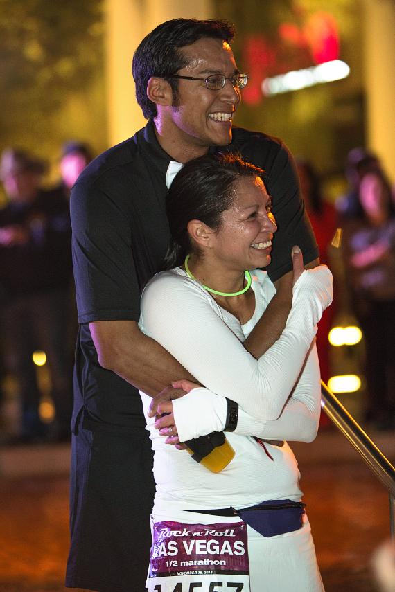 A couple embraces at Rock 'n' Roll Marathon Run-Thru Wedding
