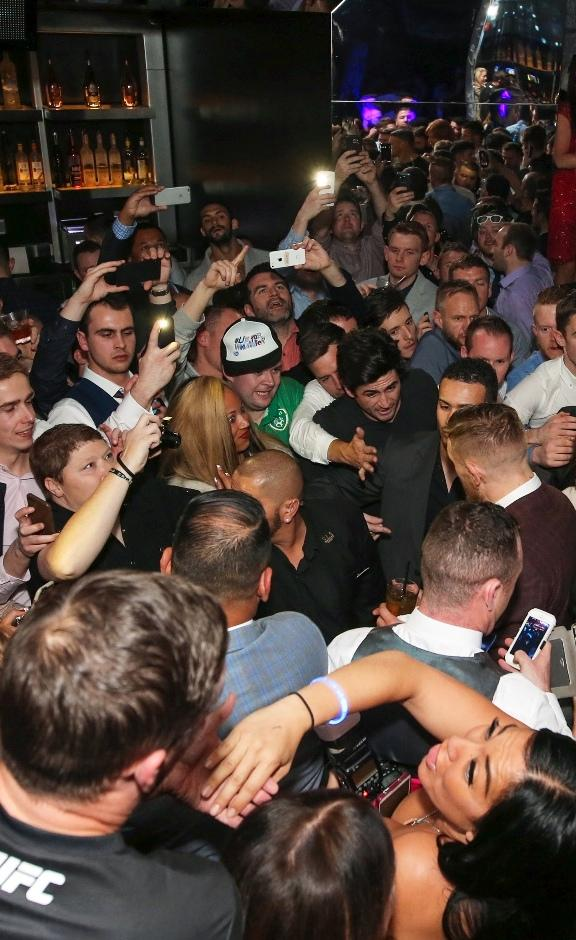 A sold-out crowd gathers around Conor McGregor for autographs and photos at Foxtail Nightclub