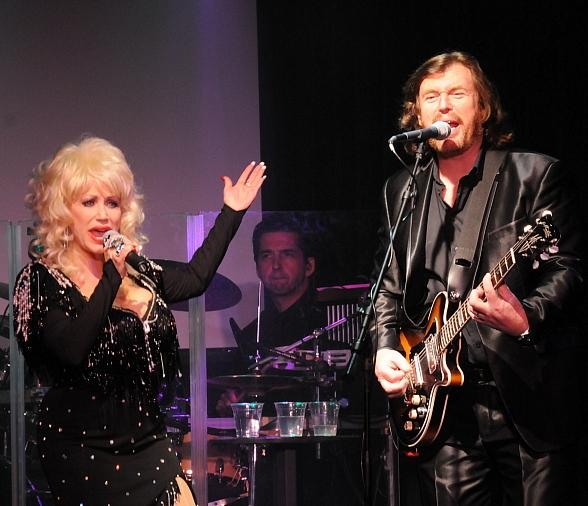 Sandy Vee Anderson as Dolly Parton performs with Michael Clift as Barry Gibbs and Australian Bee Gees band