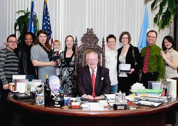 The AFAN Board of Directors poses with Mayor Oscar Goodman after the key to the city presentation. (Left to Right: Earl Shelton (Special Projects Manager), Aronca Williams (Medical Eligibility Specialist), Patricia Saavedra (Board President), Cira Jones (Director of Finance & Administration), Mayor Goodman, Nycole Cummings (Board Treasurer), Jennifer Morss (Executive Director), Scott Washburn (Board Vice President), and Erika Franco (Case Manager Level II).