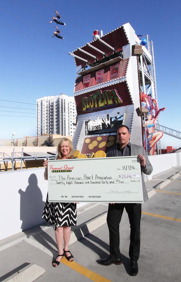 Fremont Street Experience Presents American Heart Association a Check for $28,140 Raised at SlotZilla Charity Challenge