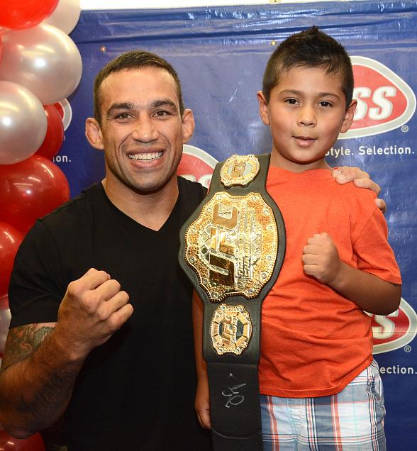 MMA Champs Fabricio Werdum and Tito Ortiz cut hair at WSS Grand Opening Celebration