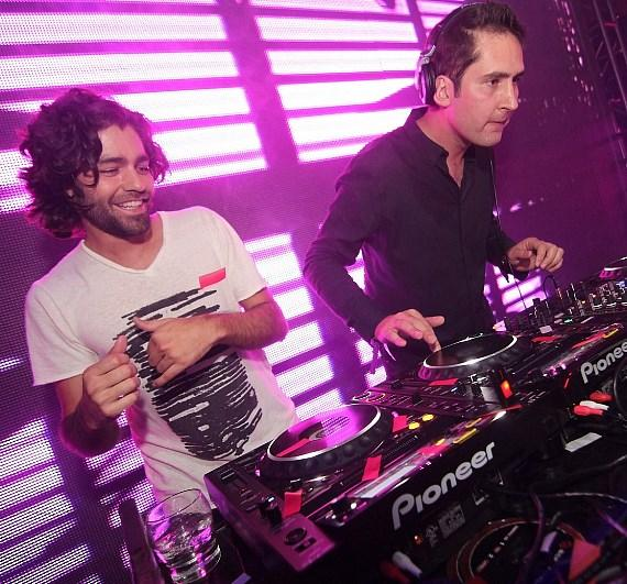 Adrian Grenier with Instagram's Kevin Systrom in the DJ  booth at Rain Nightclub
