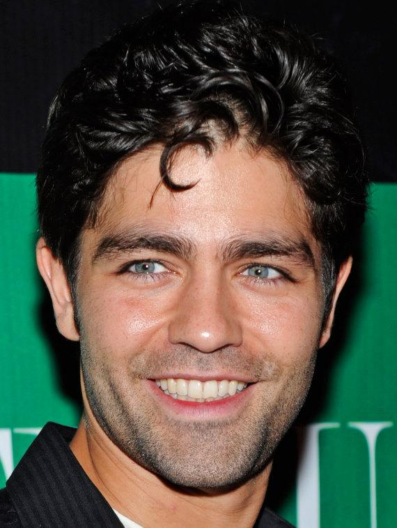 Adrian Grenier poses for photographers on the red carpet at Chateau Nightclub & Gardens