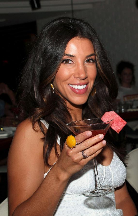 Extra correspondent Adrianna Costa displays cocktail Love at First Sight.  STK created the cocktail especially for Costa and fiancé Scott Gorelick.