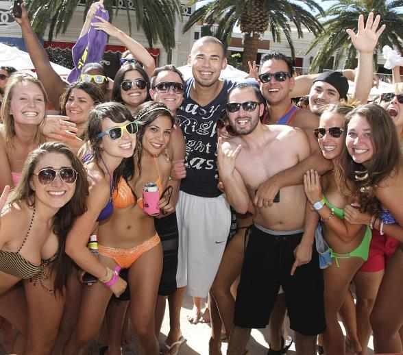 Afrojack with guests at Encore Beach Club