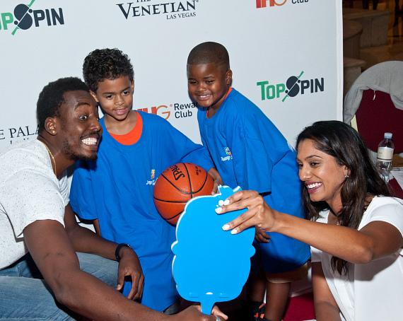 Al-Farouq Aminu taking selfies with kids from the Jump For Joy Foundation