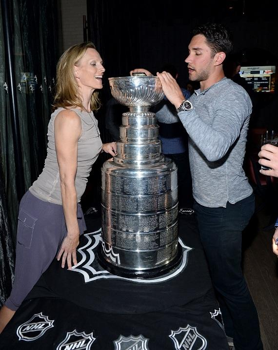 Alec Martinez showing Jenna Morton the trophy