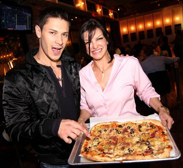 Alex Meraz enjoying a pizza with Chef Carla Pellegrino at Meatball Spot