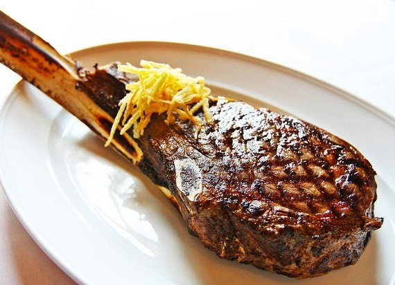 The Andiamo Tomahawk, a 32-ounce long bone rib-eye is charred to perfection