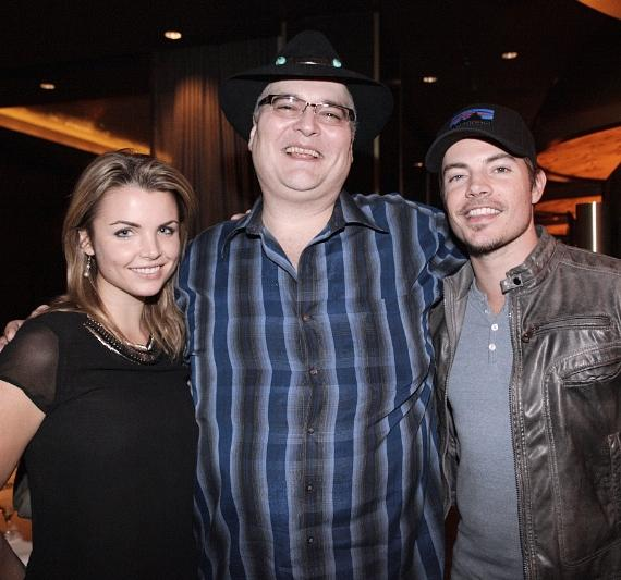 Andrea Boehlke and Josh Henderson pose with John Popper at Andiamo Steakhouse at the D Las Vegas